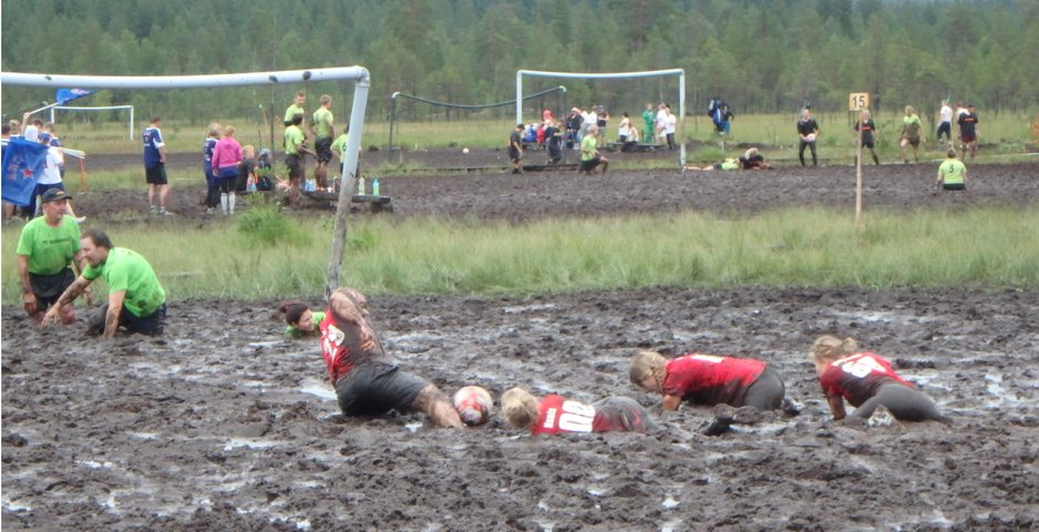 A players work hard crawling through the thick mud as they approach the opponent's goal